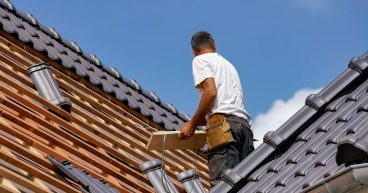 Roofer working hard